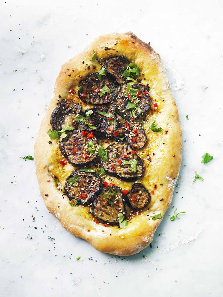 Aubergine and chilli pide: Pide is a Turkish flatbread which can be topped like pizza for a quick, easy meal. Make your dough, then top with aubergine, chilli and spices for a vegetarian lunch or supper.