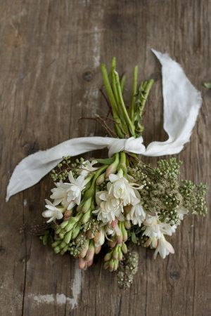Bouquet - tuberose (mix of buds and blooms, seeded eucalyptus, and Italian ruscus, tied with twine and torn linen fabric.