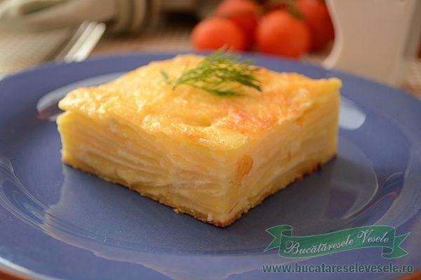 Cartofi Dauphinoise – Retete culinaremancaruri Acesti cartofi cu smantana mai sunt cunoscuti sub numele de cartofi Dauphinoise, o combinatie reusita intre cartofi, smantana si gust subtil de usturoi, cu o crusta aurie de cascaval. Ii recomand, pot fi serviti ca fel principal sau ca si garnitura. Ingrediente Cartofi cu smantana- Cartofi Dauphinoise 1kg cartofi 500