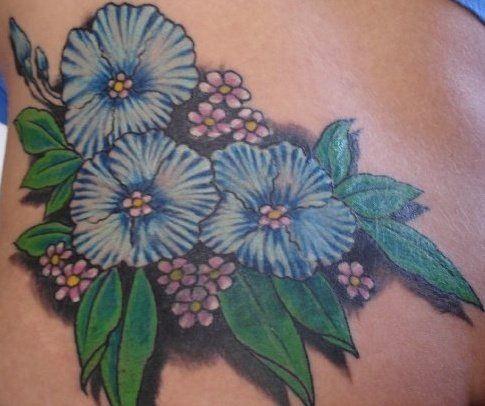 Back hip tattoo