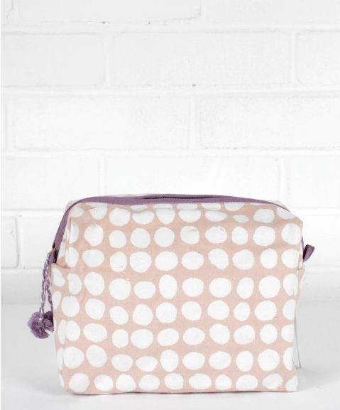 SMALL SPOT PRINT WASH BAGS, DUSKY PINK AND LILAC £19   Subtle and delicate spot print wash bags in Dusky pink with a lilac trim and pom poms. Our wash bags are made entirely by hand from block printed natural cotton canvas with a waterproof lining and interior pockets to keep all your toiletries neat and tidy.