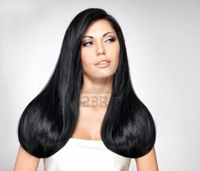 Ritratto di una bella donna bruna con i capelli lunghi rettilinei Archivio Fotografico