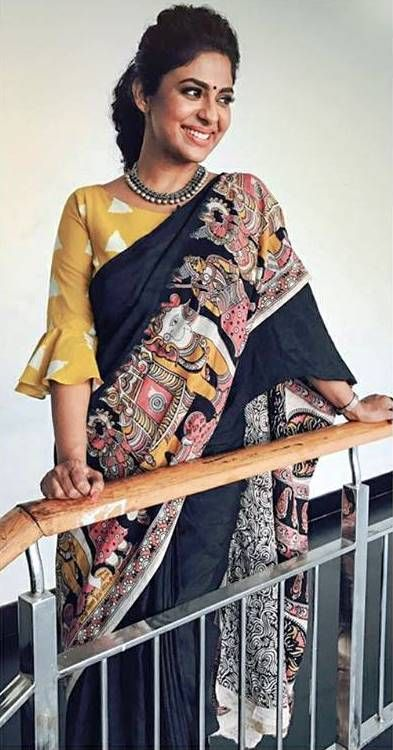 Poornima indrajith in black kalamkari printed saree with triangle printed blouse . #pranaah