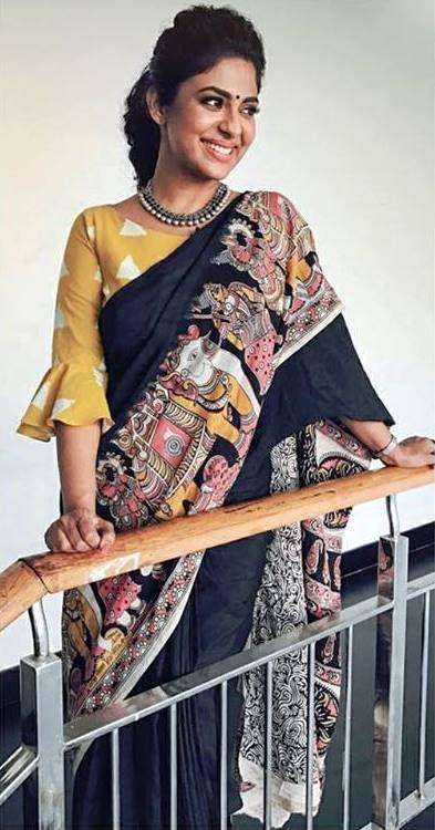 Poornima indrajith in black kalamkari printed saree with triangle printed blouse . #pranaah