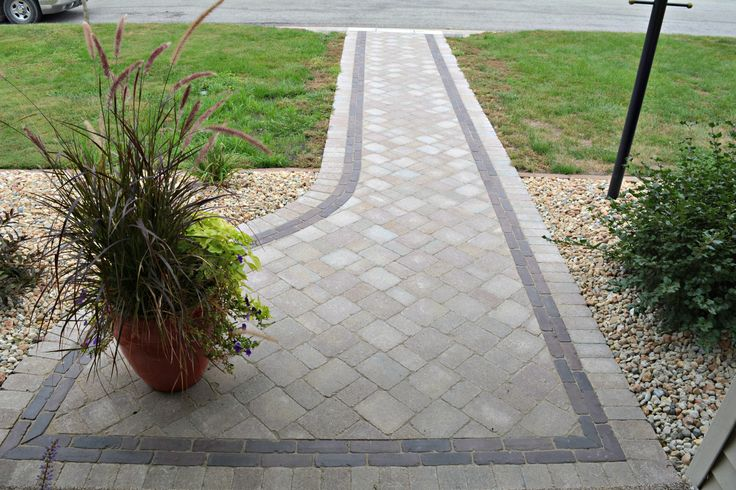 This front entrance is a Unilock paver project. It is made with Brussels Block and has a Copthorne border. #Unilock #UnilockAuthorizedContractor