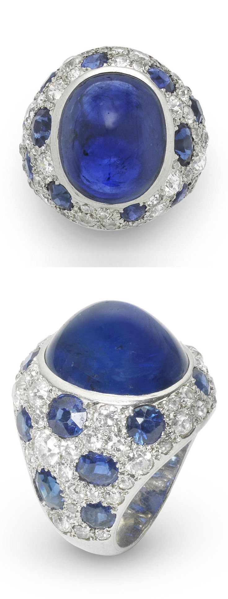 An Art Deco sapphire and diamond bombé ring, circa 1930. The large central cabochon sapphire within a mount pavé-set with old brilliant, brilliant and single-cut diamonds and circular-cut sapphire 'spots', mounted in platinum, diamonds approximately 2.15 carats total, cabochon sapphire approximately 17.00 carats. #ArtDeco #ring