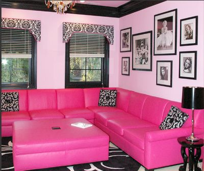 This neon pink, black and white create a girl and exciting vibe to this family room. The pink really adds a pop of color to this vibrant room