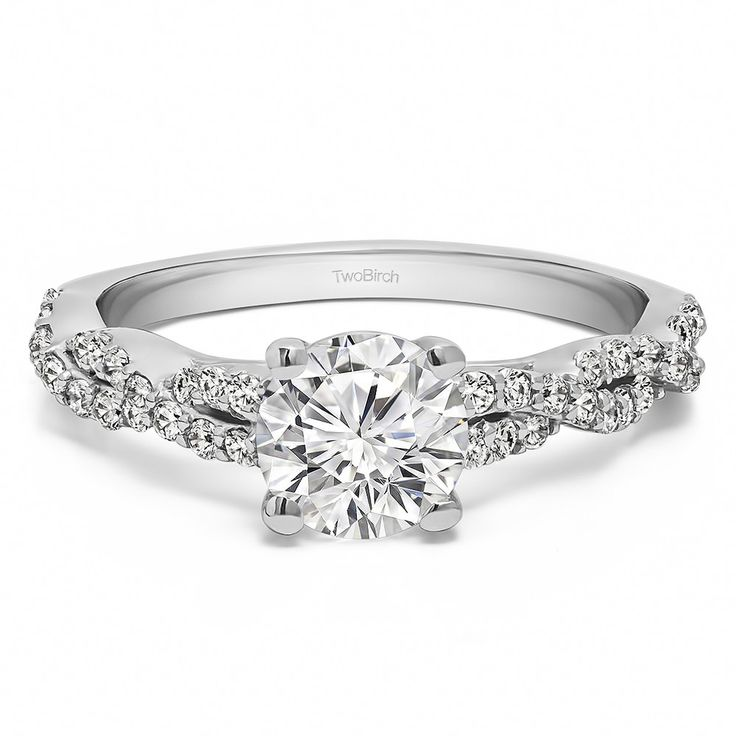 The engagement ring features a round stone, set in four prongs. The band on the engagement ring features round stones set in an infinity design. Each stone is handpicked by our team of gemologists to ensure the perfect engagement ring. Each center diamo