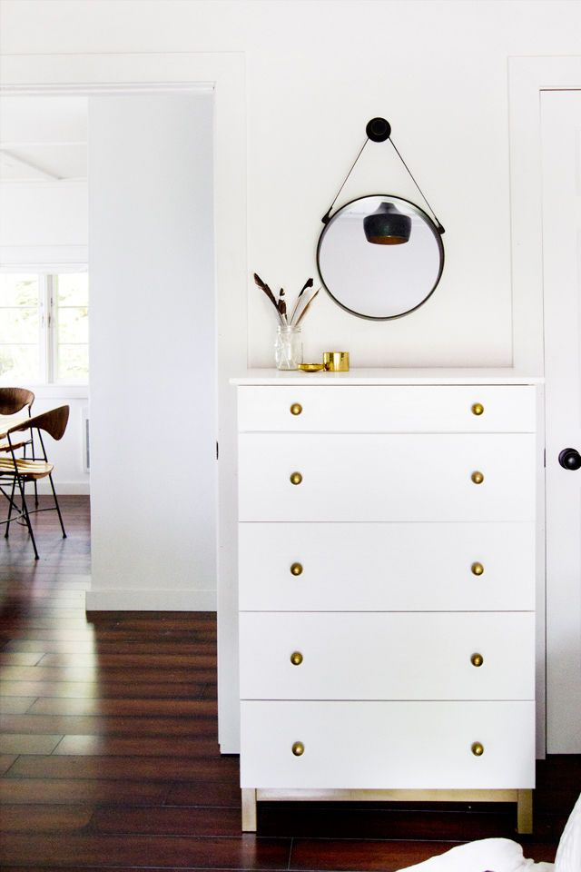 Here's a simple one with huge impact: Blogger Sarah Sherman Samuel of Smitten Studio upgraded the plain-wood TARVA chest with a coat of white paint and some brass knobs. The end result? Stunning.