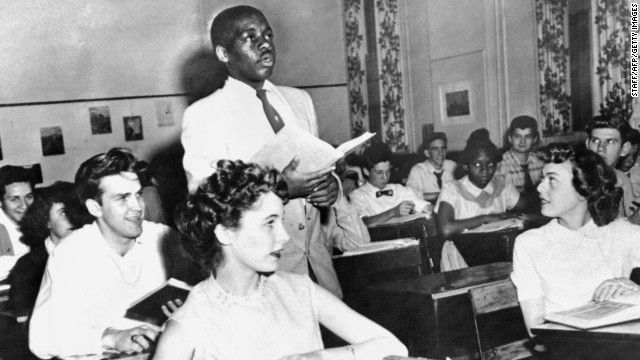 Brown v. Board of Education (1954):</strong> Nathaniel Steward recites his lesson surrounded by white classmates at the Saint-Dominique School in Washington. In Brown v. Board of Education, the Supreme Court ruled that it was unconstitutional to separate students based on race.