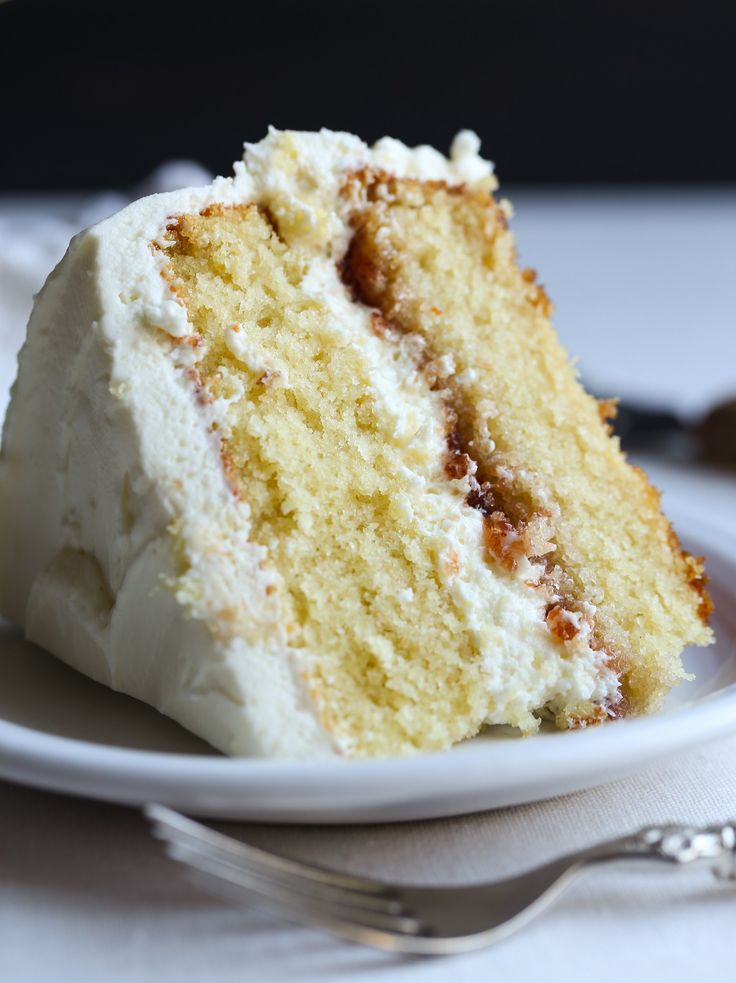 DELICIOUS White Chocolate Cake This is so genius because you still have the buttery white chocolate flavor, but it mixes into the batter making it thinner but not adding more fat…which would create a heavier, denser cake.