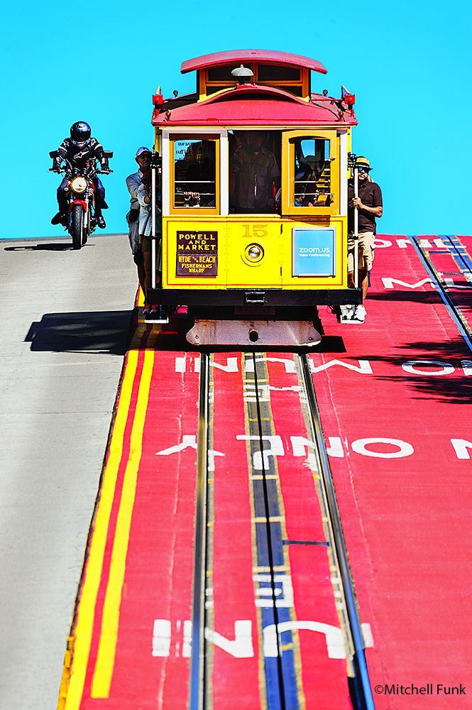 Yellow Cable Car And Motorcycle Going Down Powell Street, San Francisco By Mitchell Funk www.mitchellfunk.com