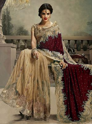 Look #Elegant, be #stylish with maroon and  chiku embroidered velvet saree with blouse. #celebrate #valentine spread #love . click here -> http://bit.ly/1TIiaTf