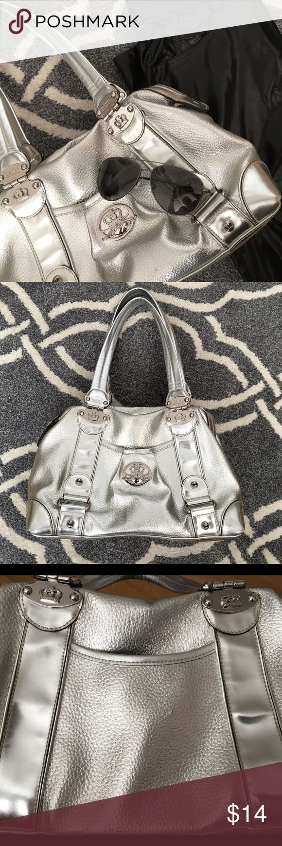 Kathy Van Zeeland silver metallic bag! Kathy Van Zeeland silver metallic bag! This bag is super fun and has been through some good times! The interior has one small pen mark in one of the corners (hard to see when looking in the bag). While it's still in good shape, the exterior has some wear and tear. The feet are somewhat worn, some marks here and there (see last photo above). Priced accordingly. I don't trade. Reasonable offers welcome. Thanks! 😊 Kathy Van Zeeland Bags