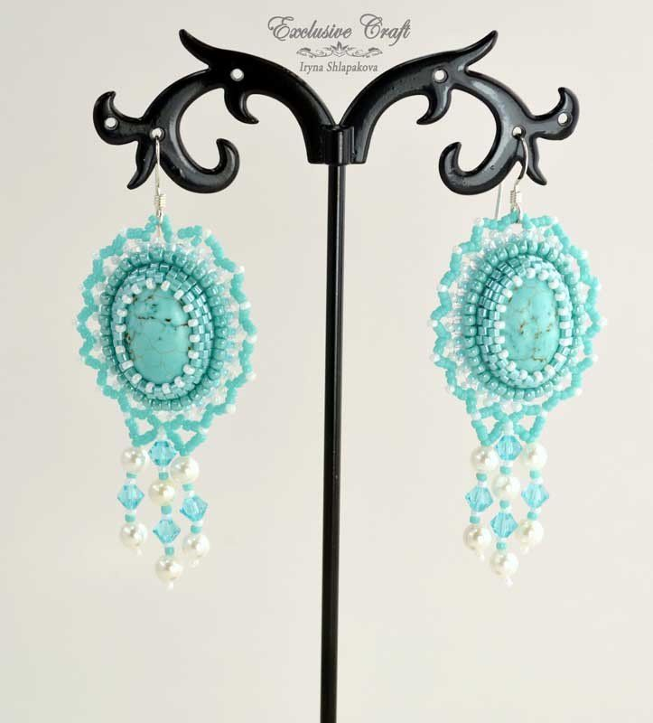 """Cute and summery beaded dangling earrings """"Aqua Sky"""" made with Turquoise colored Howlite cabochons, Swarovski crystals, Shell Pearls beads and Japanese seed beads. The backing is white genuine leather"""