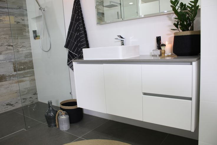 Ayden's Bathroom has a beautiful Vista wall hung vanity, rectangle fine line basin with a kubica tap