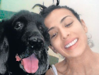 Pia Trivedi and her black Cocker Spaniel named Skypoo. The doggie is named after Winnie the Pooh. Pic/mid-day archives | #indipin