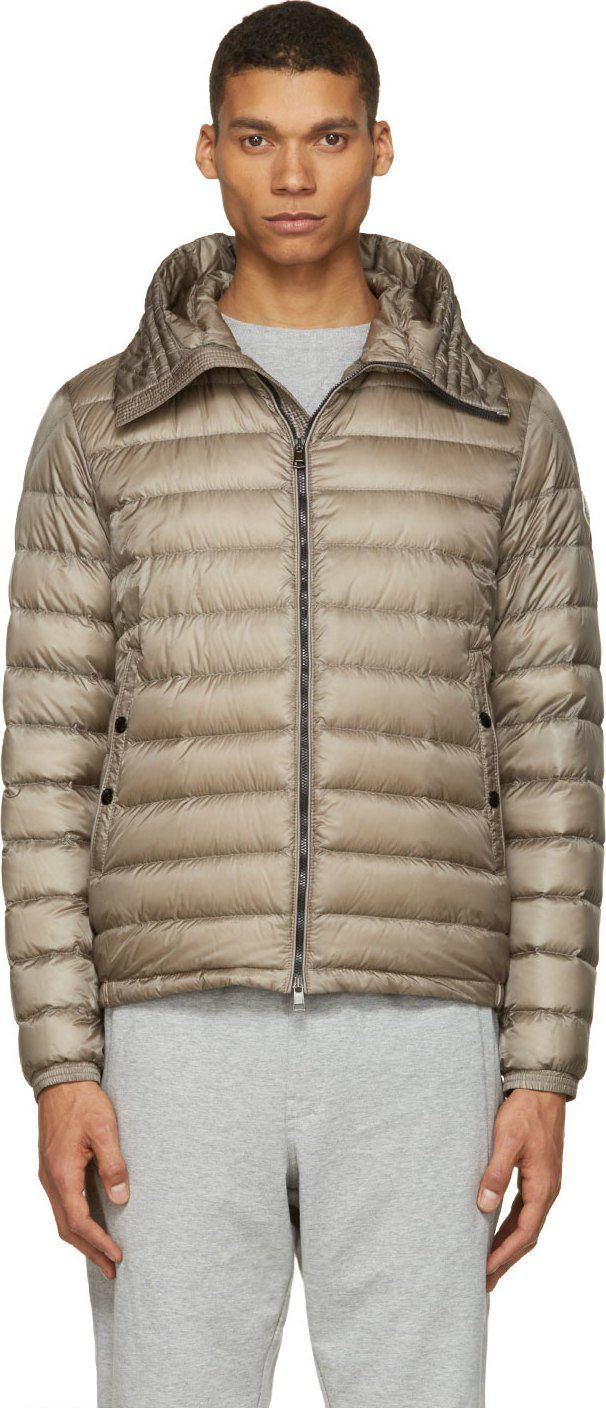 Moncler - Grey Dijon Quilted Down Hooded Jacket $1,150 USD 100% nylon.  Fill: 90% down, 10% feathers.  Long sleeve down hooded jacket in grey. Bungee drawstring at stand collar hood. Two-way zip closure. Snap-buttoned welt pockets at front face. Logo patch at upper sleeve. Elasticized sleeve cuffs. Fully lined. Tonal stitching.