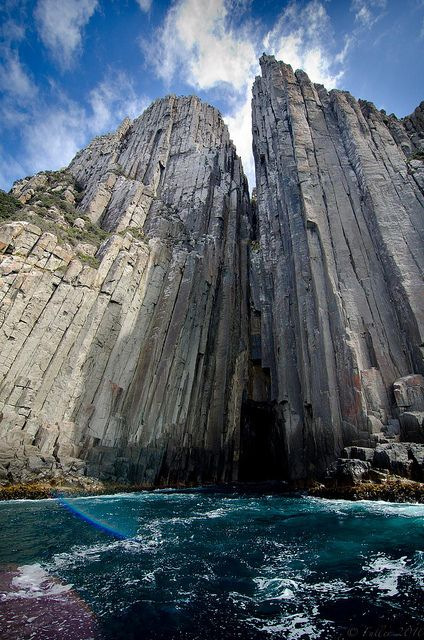 "Jointed dolerite columns forming the Cape Pillar sea cave in the coast of the ""Land-Down-Under""..."