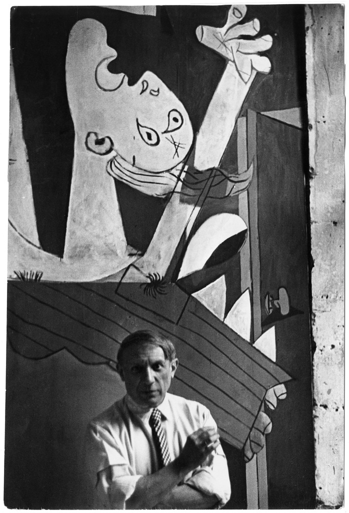 Picasso in front of his painting Guernica, Paris, 1937 by David Seymour