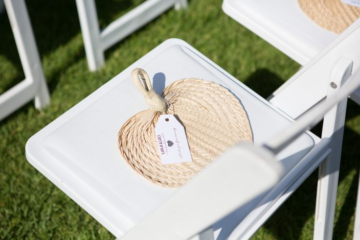 Palm fronds fans for wedding guests on a balmy day #weddingguestgifts #summerwedding #islandtheme PC: Liv Style photography