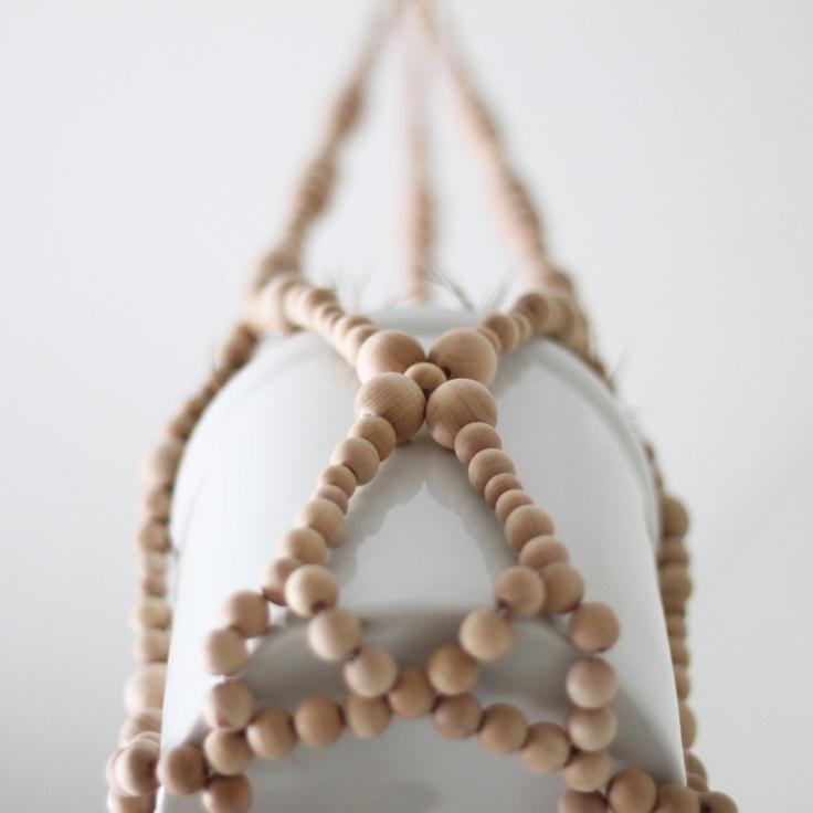 beaded plant hanger  - modern planter - natural wood beads - scandinavian decor. $92.00, via Etsy.