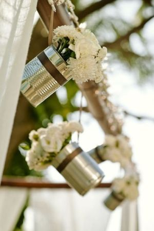 Flowers in ribbon wrapped cans for a rustic wedding by may