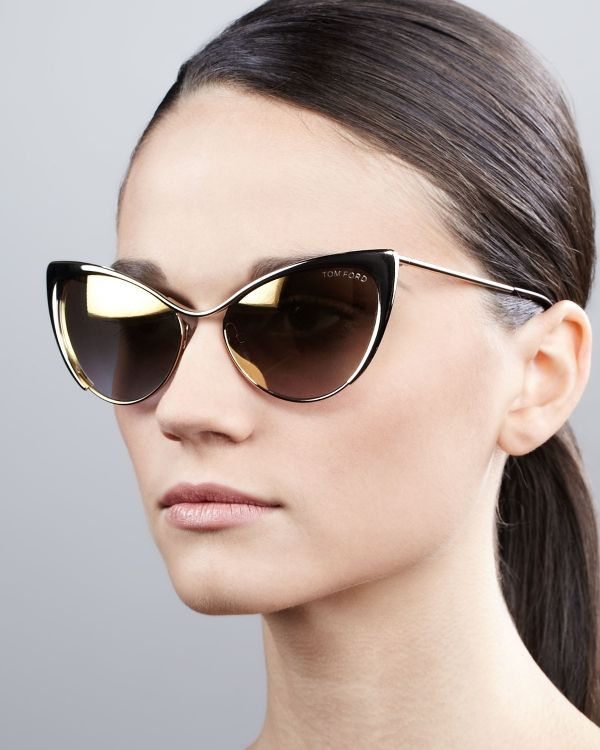 A daring design for the fashion-conscious woman, Tom Ford's Nastasya cat eye sunglasses come with polished gold-tone frames and mirrored lenses for a sleek look with a high fashion edge. Team with casual basics for a luxe spin on casual dressing.