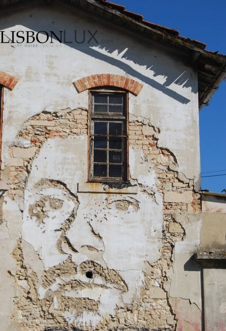 """Without the use of paints, Portuguese artist Alexandre Farto (aka """"Vhils"""") depicts, or rather, sculpts expressive faces on the walls of dilapidated buildings. He's now one of the biggest names in the street art world, having had work featured on the cover of The Times after passing through London, Italy, USA and other countries.  #Lisbon, Rua de Cascais in Alcântara near the Santo Amaro Docks and represents the American street artist Brad Downey, his friend. (all rights reverved by Lisbon…"""