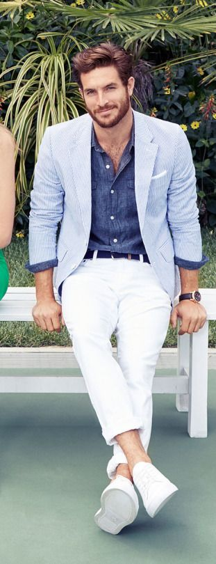 Smart casual rolled for summer. Seersucker jacket with a chambray button down and white chinos.