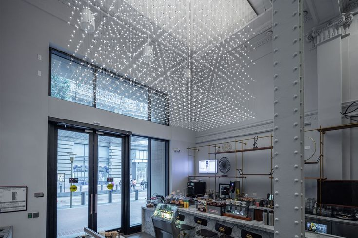 The Axiom Hotel in San Francisco is a tech-forward hotel where history meets digital revolution. Its amenities are unrivaled anywhere in the city, and its guests are greeted with a one-of-a-kind chandelier in the hallway, consisting of LED chips arranged in a geometric pattern. In collaboration with Stonehill & Taylor Architects based in New York. #design #light #LEDlighting #lighting #chandelier #elegance #hotel #hospitality #lobby