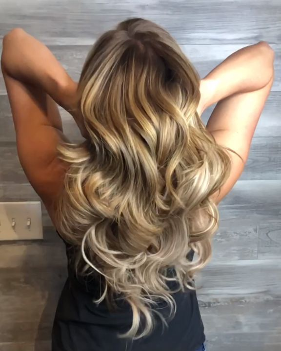 This full, beautiful curled balayage look was created using two packs of Glam Seamless 20