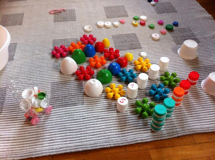 Toy push-cart - reused bottle and bottle caps: