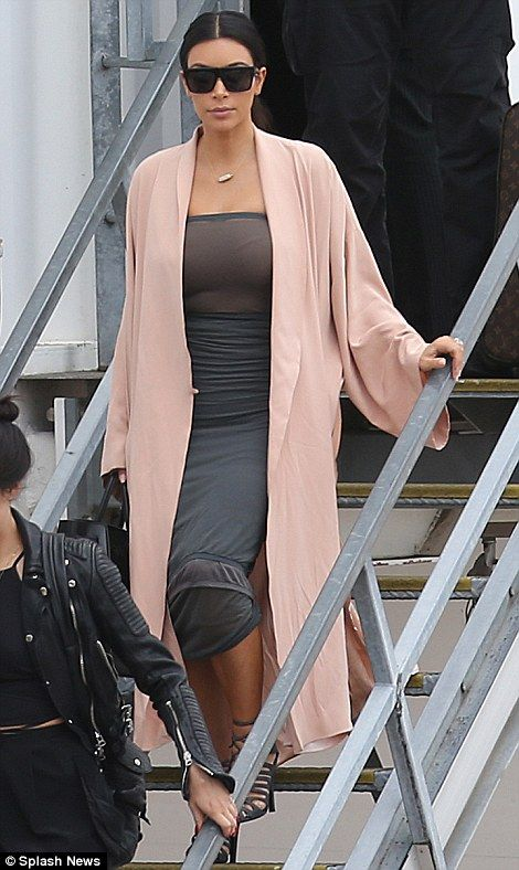 Something more comfortable: Kim was in a much looser garment when she touched down at Melbourne airport on Tuesday