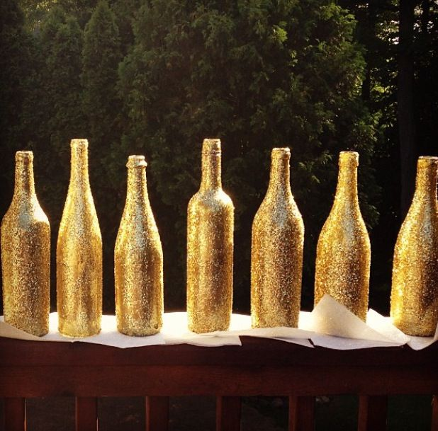 Gold wine bottles i made for centerpieces for wedding made for How to make glitter wine bottles
