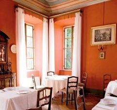 The dining room in Castello di Verduno, in Italy's Piedmont Region, where guests can sample Barolo from the castle's cellars.