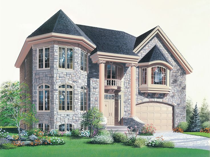 This Two-Story Stone Home Has A Turret And Bay Window