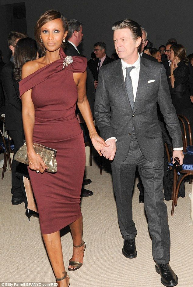 Dapper: David Bowie and wife of 21 years Iman broke cover to attend an event in New York honouring Tilda Swinton