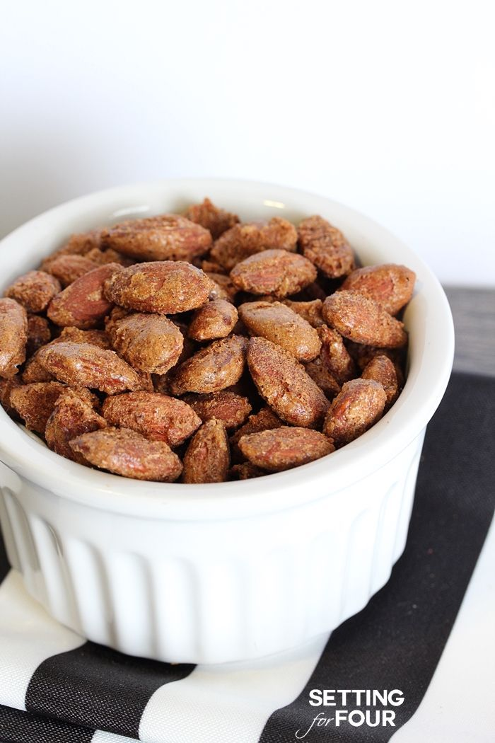 This easy recipe for delicious Pumpkin Pie Spiced Nuts is completely addictive! Makes the perfect snack for game night, holiday parties and great idea for holiday gift giving too! www.settingforfour.com