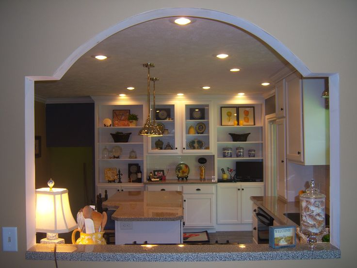 Unique wall cut out to open kitchen into dinning room for Dining hall wall design