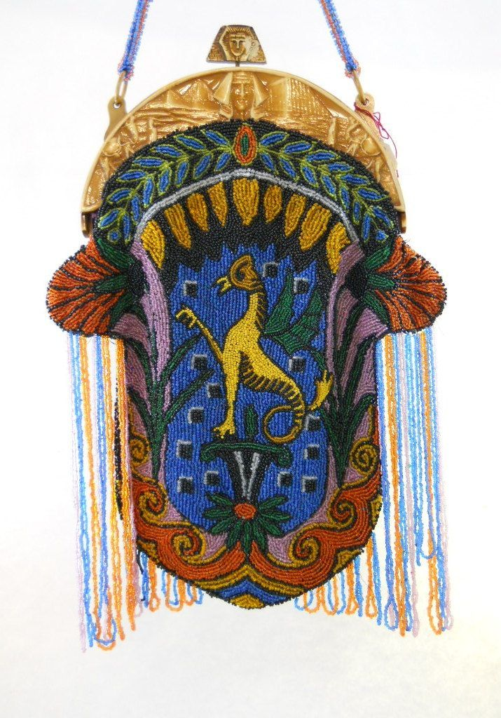 "1920's  microbeaded purse with Egyptian Revival theme - front and back. The purse measures 8 7/8"" wide at the widest measurement and 11 1/2 inches from toggle to base.  Molded celluloid frame with sphynx and camels. Magnificent."