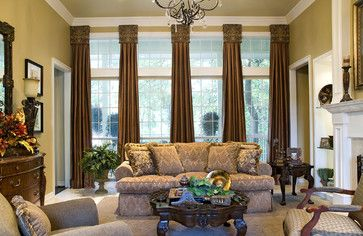 On the windows we used cornice boards covered in a damask patterned fabric and attached honey-colored silk drapery panels inspired by grand European pillars. These treatments were ideal for framing the picturesque outside view.