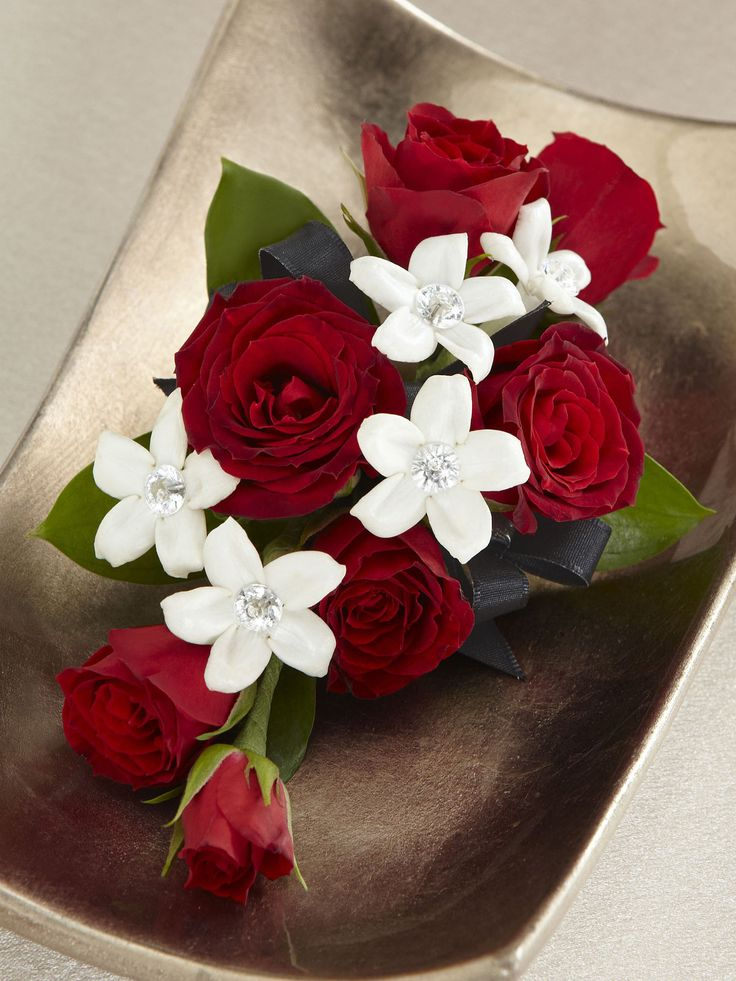 This pretty red rose corsage is the perfect accessory for the wonderful women in your life on your wedding day.