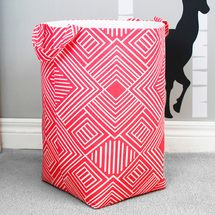 All fabric clothes hamper in coral fabric. Compact size.  With handles