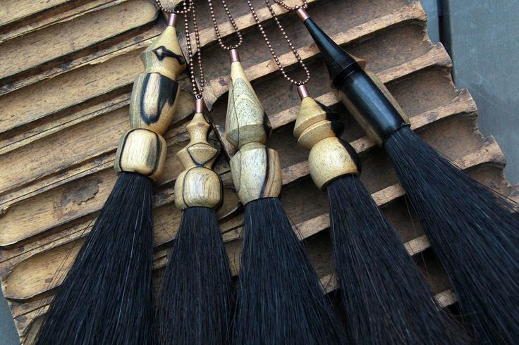 turned wood and tassel necklaces