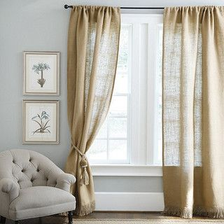 Burlap drapes are beautiful and let just enough light through the panels. This set in particular offers a fringed hem, an unexpected but elegant detail.