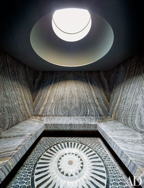 Book-matched marble lines the stunning steam room in decorator Laura Santos's Manhattan townhouse
