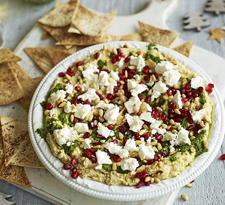 Layered houmous with herb oil, feta and pomegranaat pits