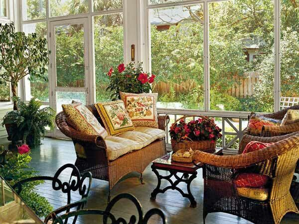 Enclosed porch decorated with a flair grabbed my attention but the view out the windows really made me love this porch.