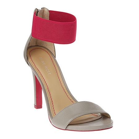 "As seen in the March issue of InStyle.....Color block platform sandal with elastic fabric ankle strap and leather upper.  Back zipper closure.  Measurements: heel 4"" and .25"" platform."